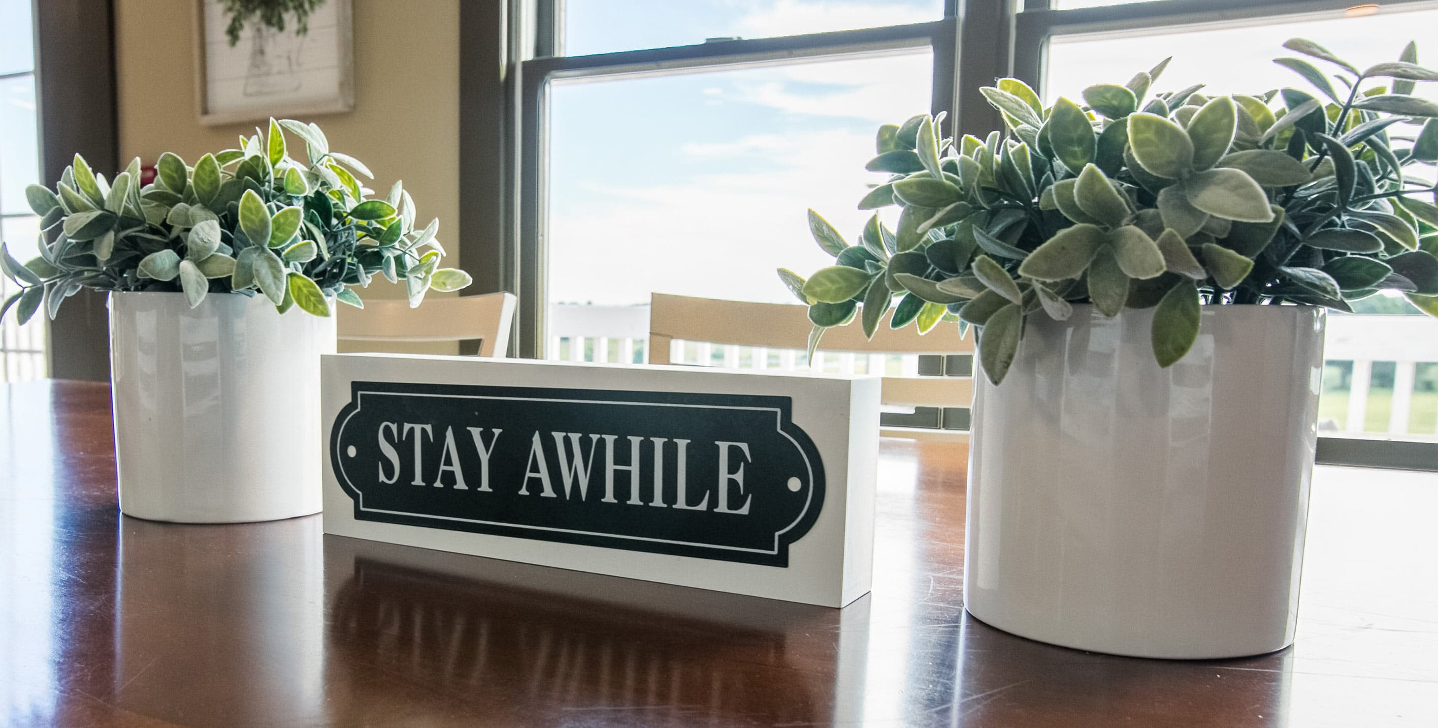 Sign that says Stay Awhile