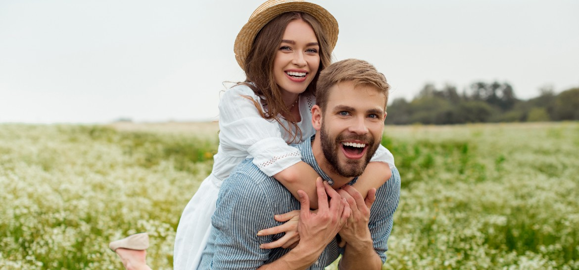 couple outside laughing